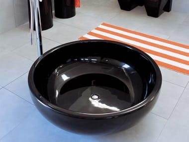 Freestanding Pietraluce® bathtub with shower FONTANA