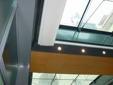 Motorized sliding awning with guide system ORIZZONTI