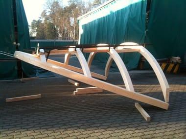 Strutture prefabbricate per abbaini, falde curve, pensiline Elementi in legno lamellare