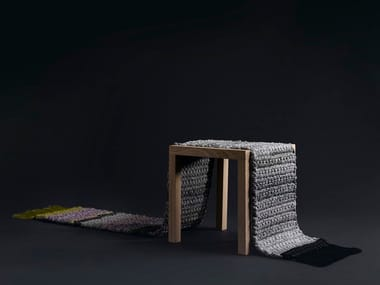 Low wooden stool RUG STOOL