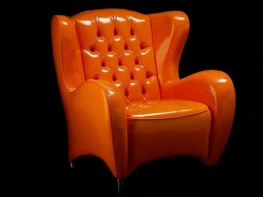 Tufted leather armchair with armrests SCHINKE | Leather armchair