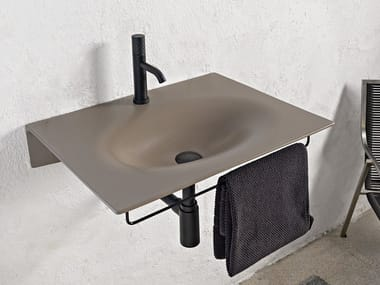Wall-mounted ceramic washbasin with towel rail VEIL | Washbasin with towel rail