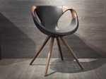 Trestle-based leather chair