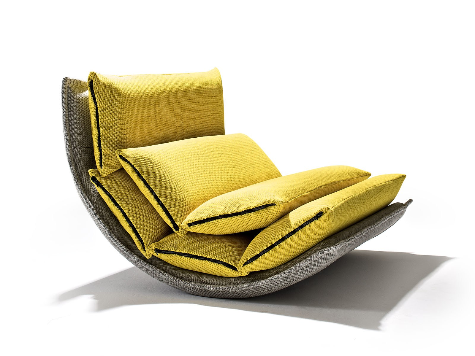 Rocking upholstered armchair DIM SUM By Montis design Simon Pengelly
